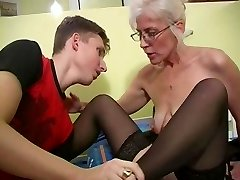 Mature with Platinum Hair Glasses and Stockings Wakes the Dude