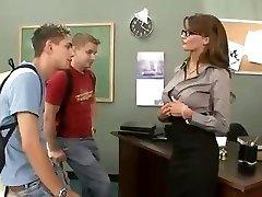 Big-boobed brunette teacher fucks and sucks her 2 students in threesome