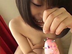 Cute Japanese girl sticking into fake cock