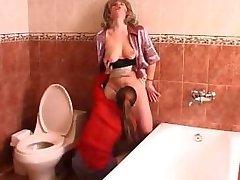 Russian teen lesbian seduces a mature woman in bathroom