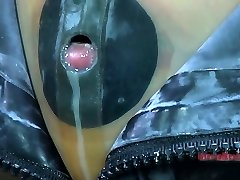 Tight dark-hued rubber mask makes Kristine Andrews suffocate and cry