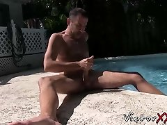 Lusty caboose pirate plays with his prick by the pool and ejaculates