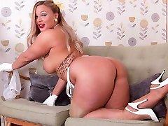 Big globes platinum-blonde strips in retro lingerie wanks in high heels