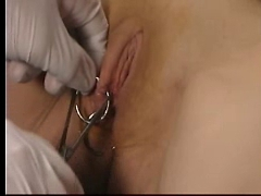 Slave getting tits and pussy piercings - pierced slut