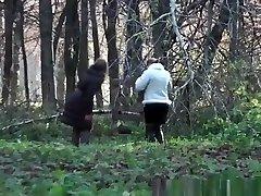Two women take a pee outdoors in public
