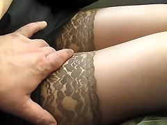 Touching her legs in tan pantyhose in a bus