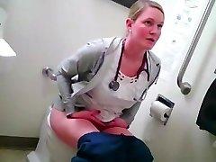 platinum-blonde nurse in rest room