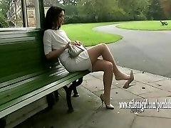 Pretty babe displays off her silky slick nylon legs and posh high heels