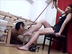 Caged Asian sole slave worships her mistress