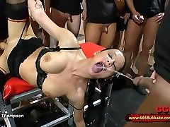 Filthy brunette biotch used as a toilet in a huge gangbang