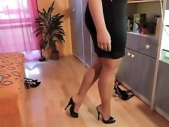 Amateur in nylon tights and high heel shoes