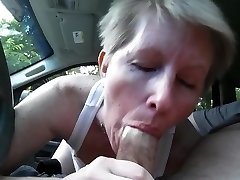deepthroating dick in car
