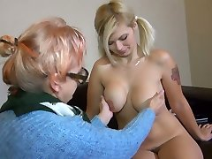 Old ugly bitch in glasses Bernadett tickles fresh pussy of pigtailed huge-titted lady