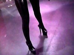 Latex-clad Misstress Lolita fooling around with her slaves spunk-pump