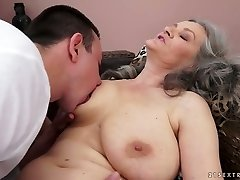 Sex-starved granny with massive natural tits gives hot deep throat to her lover