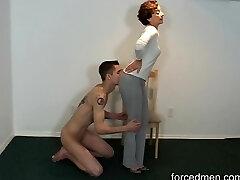 Naked slave licks mistress' legs for worship
