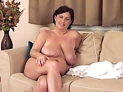 Mellow busty aged female haning an incredible masturbation