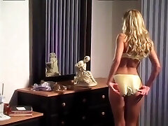 Subjugated guy gets spanked by a sexy femdom