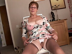 Chesty mature granny in crotchless panties shows hairy pussy