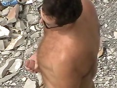 Daddy stroking his huge cock at the beach