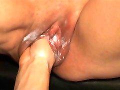 Fist fucking a creamy mature pussy
