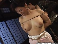 Asian babe in rope bondage scene