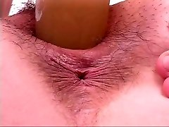 Horny bitch riding dildo like a cock at gym