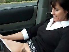 Sexy milf masturbates in car