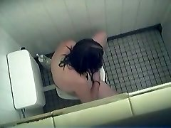 Girl toilet pee action with sliding the tampon in nub