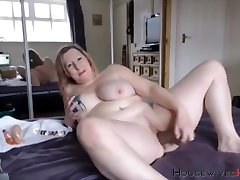 BBW mature Carmen with huge inked tits rides a dildo