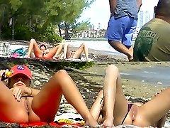 Voyeurchamp.com Exhibitionist Wives Taunt Voyeur Beach Rods