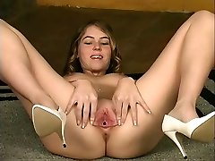 Brunette peels off naked by stairs