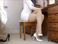 Lady Tan Pantyhose gams and white shoes .
