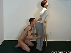 Naked slave eats mistress' legs for worship