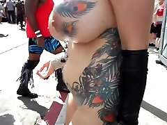 Busty mature exhibitionist with touching in public