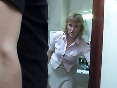 Mature mom takes a piss on the toilet and gets interrupted by her stepson for a fuck