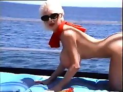 busty blonde in red bikini