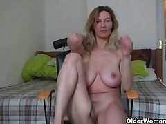MILF with big boobs rubs her mature pussy