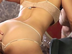 Full of lust and passion brunette Sunny Leone gets rid of lingerie and masturbates