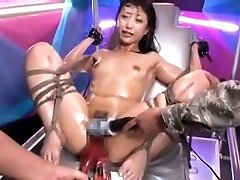 Fastened Asian slut gets stimulated by toys to orgasm