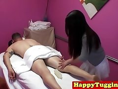 Oriental masseuse with tattoos jerking