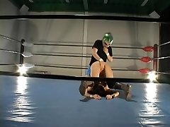 Busty hairy Jap pummeled in a wrestling ring