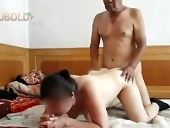 Chinese grandpa providing it to grandmother from behind