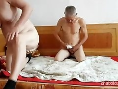 Handsome Chinese grandpa giving boinking