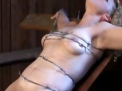tied with barbed wire, kicking soft boob and pussy meat