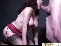 Busty cougar in stockings chooses it doggy style
