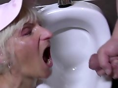 Kinky mature twat guzzles pee in male s wc