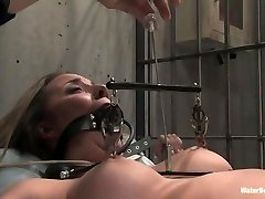 Naked beauty strapped up in prison, masturbate pussy and bathed