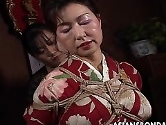 Asian mature mega-bitch has a rope session to suffer
