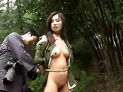 Chinese army girl trussed to tree 3